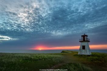 Cloudy sunrise over Cap Alright lighthouse at Havre-aux-maisons on Magdalen Islands, Quebec --- Lever du jour nuageux au phare du cap Alright a Havre-aux-maisons aux Iles-de-la-Madeleine